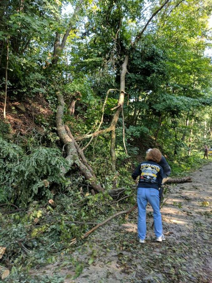 Cleaning up a fallen tree across the trail.
