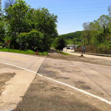 2015: No more tracks at the Meadowbrook Road crossing.