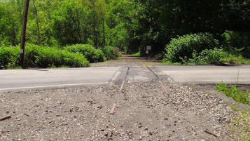 2015: The crossing at Saunders Station Road still has tracks.
